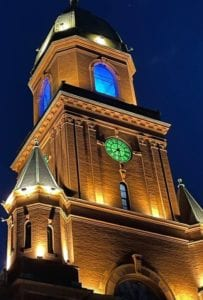 Lewiston City Hall with the clock face lit green